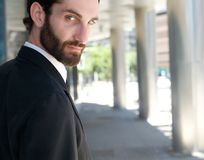 Cool young businessman with beard from behind Stock Photography