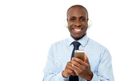Cool young businessman enjoying music Stock Photos