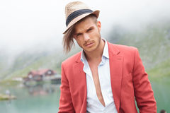 Cool young casual man near lake Royalty Free Stock Images