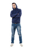 Cool young confident man in blue sweatshirt with crossed arms looking at camera. Full body length portrait isolated over white studio background Stock Image