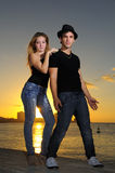 Cool young couple standing at sunset Royalty Free Stock Images
