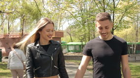 Cool young couple walking in the park. Happiness and relationship. Young inlove couple stock video footage