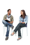 Cool young couple writing in notepads Royalty Free Stock Photography