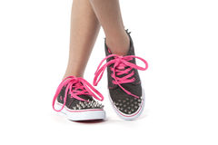 Cool young girl posing with new shoes with studs Royalty Free Stock Photo