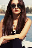 Cool young girl in sunglasses Stock Photography