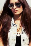 Cool young girl in sunglasses Royalty Free Stock Images