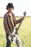 Cool young guitarist outdoors Stock Photo