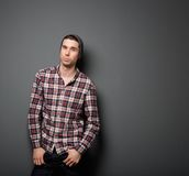 Cool young guy in checkered shirt and hat Royalty Free Stock Photos