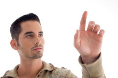 Cool young guy pointing upwards Royalty Free Stock Photos