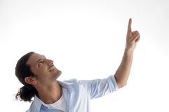 Cool young guy pointing upwards Royalty Free Stock Photography