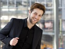 Cool young guy smiling with black suit. Close up portrait of a cool young guy smiling with black suit Stock Photo