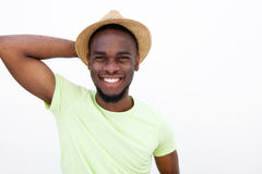 Cool young guy smiling with hat on white background Royalty Free Stock Image