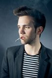 Cool young guy smoking Stock Photo