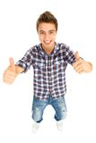 Cool young guy with thumbs up Royalty Free Stock Images