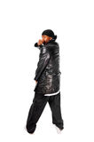 Cool young hip-hop man on white background. Cool young hip-hop dancer on white background Royalty Free Stock Images