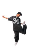 Cool young hip-hop man on white background. Cool young hip-hop dancer making a move Royalty Free Stock Images