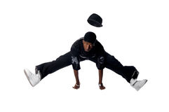 Cool young hip-hop man on white background. Cool young hip-hop dancer making a move Stock Photo