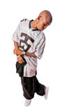 Cool young hip-hop man on white background. Cool young hip-hop dancer making a move Royalty Free Stock Photos