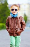 Cool young kid walking the street. Cool young kid walking the city street Royalty Free Stock Photography
