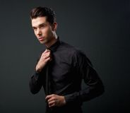 Cool young man in black shirt and tie Stock Images