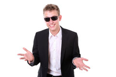 Cool young man with boyish grin Royalty Free Stock Image