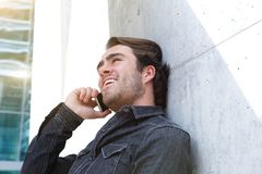 Cool young man calling by mobile phone outside Royalty Free Stock Photo