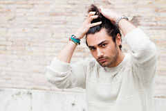 Cool young man fashion model, hairstyle. Hand in the hair Stock Photography