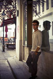 Cool young man in front of urban setting Royalty Free Stock Photo