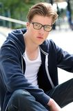 Cool young man with glasses. Close up portrait of a cool young man with glasses royalty free stock photo