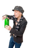 Cool young man with a green bottle Stock Image