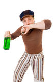 Cool young man with a green bottle Royalty Free Stock Photo