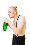 Cool young man with a green bottle Royalty Free Stock Photos