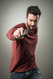 Cool young man holding a gun Royalty Free Stock Photos