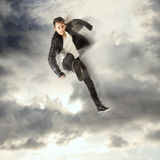 Cool young man jumping and kicking Stock Images