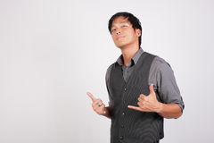 Cool young man making hand signs Stock Photos