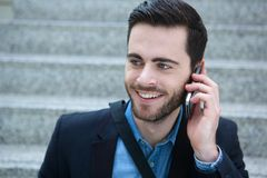 Cool young man with mobile phone. Close up portrait of a cool young man with mobile phone Royalty Free Stock Photo