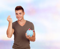 Cool young men with a money box Stock Images