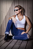 Cool young sexy girl in jeans Stock Photos