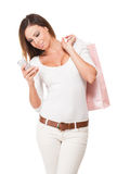 Cool young shopper using smartphone. Royalty Free Stock Photo