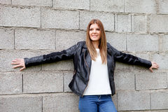 Cool young woman with black jacket Royalty Free Stock Image
