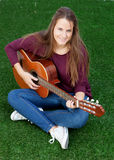 Cool young woman playing guitar Stock Image