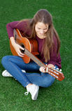 Cool young woman playing guitar Royalty Free Stock Images