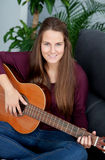 Cool young woman playing guitar Royalty Free Stock Photo