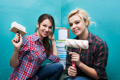 Cool young woman and repairs Stock Photo