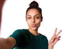 Cool young woman taking selfie Royalty Free Stock Images