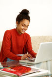 Cool young woman working on laptop at home. Portrait of a cool young woman working on laptop at home Royalty Free Stock Images