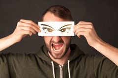 Cool youngster looking with a paper hand drawn eyes Stock Photography