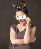 Cool youngster looking with a paper hand drawn eyes Royalty Free Stock Photos