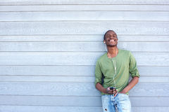 Cool yoyung black guy listening to music with earphones Royalty Free Stock Image