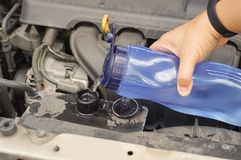 Coolant checkup automobile dirty engine bay. Coolant checkup automobile dirty engine fill up coolant technician checkup Royalty Free Stock Photos